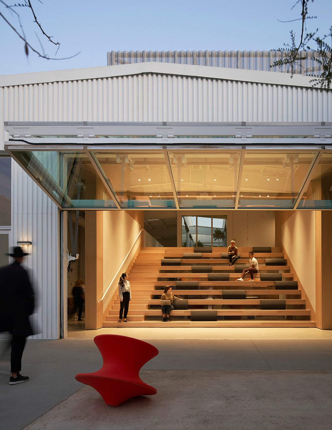Outdoor courtyard anchors the East and West office working spaces. Kevin Scott