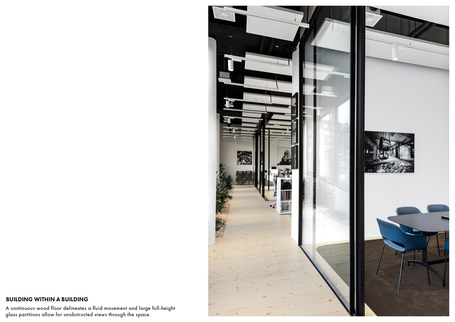 A continuous wood floor delineates a fluid movement and large full-height glass partitions allow for unobstructed views through the space. Delphine Burtin}