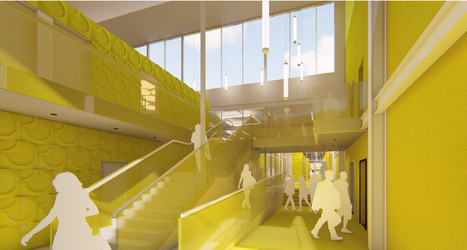 Entry for students from parking lot terminates yellow corridor as a facility wayfinding space. University of Arkansas Community Design Center