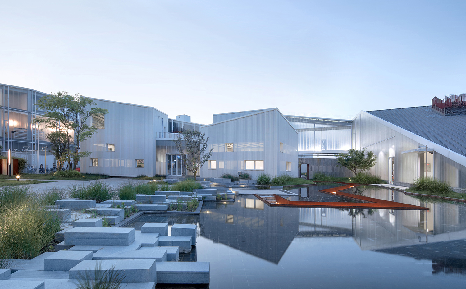 Warm - central courtyard and service center in the evening Arch-Exist Photography