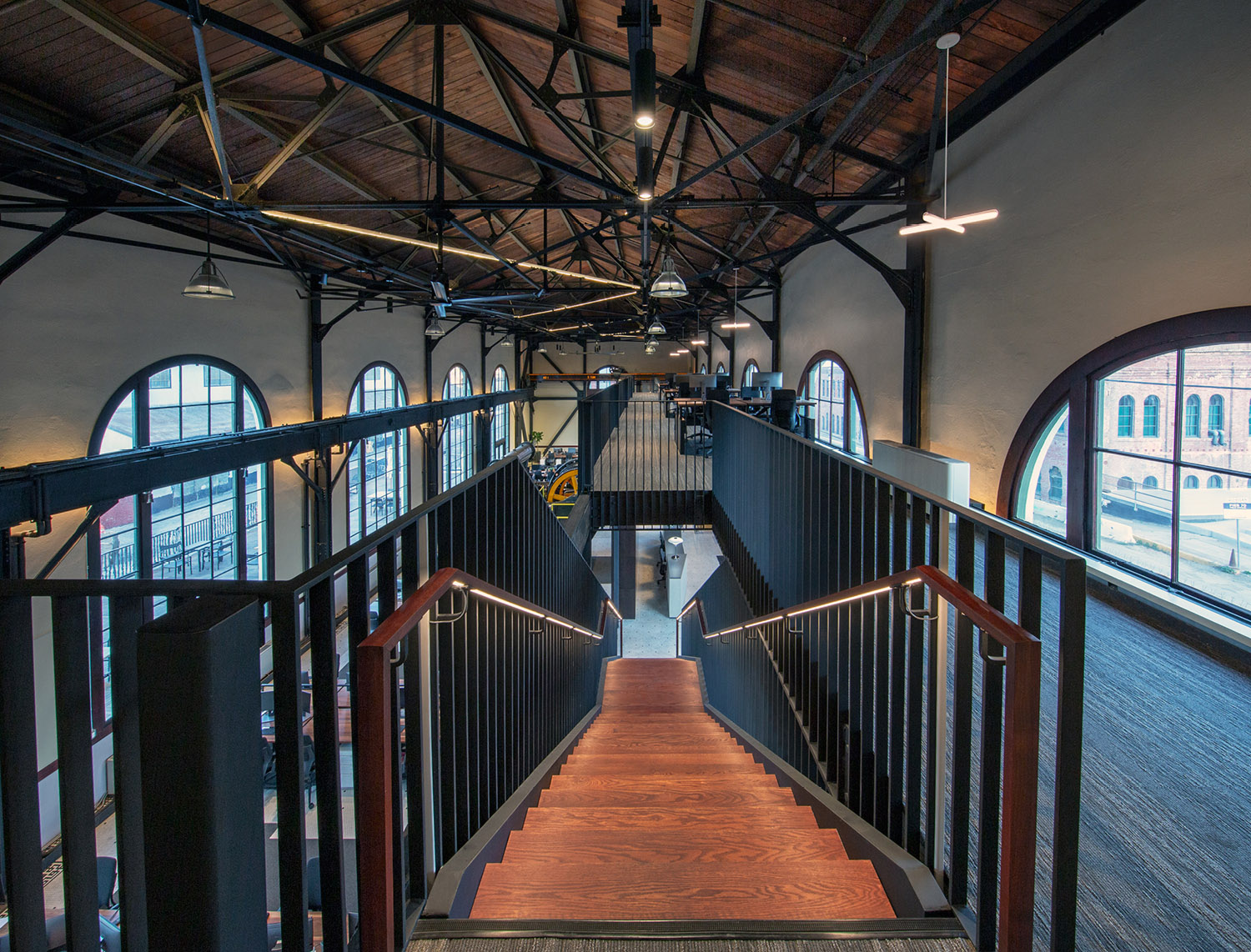 A new mezzanine level is constructed along the south and the west sides of the structure, providing an overview of the main level. The mezzanine structure and the stairs leading to it are the most signific Billy Hustace