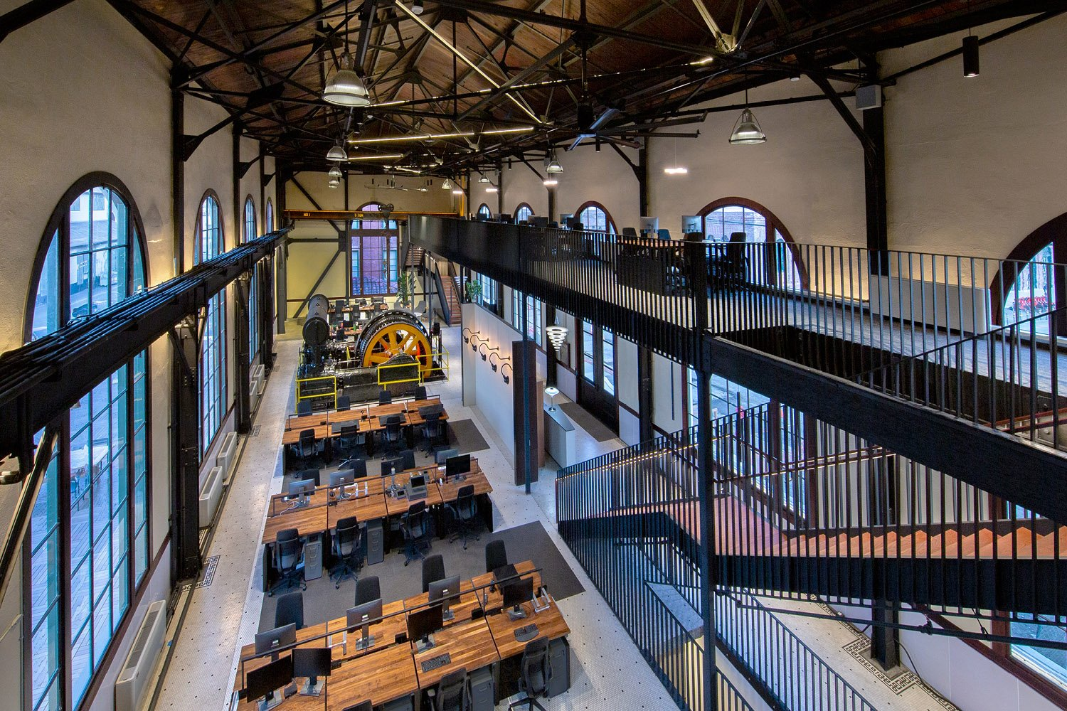 In adapting the Powerhouse for office use, the architect's and developer's achieve design objectives include arranging spaces to maximize the inherent attributes of the building such as vistas of a park in Billy Hustace