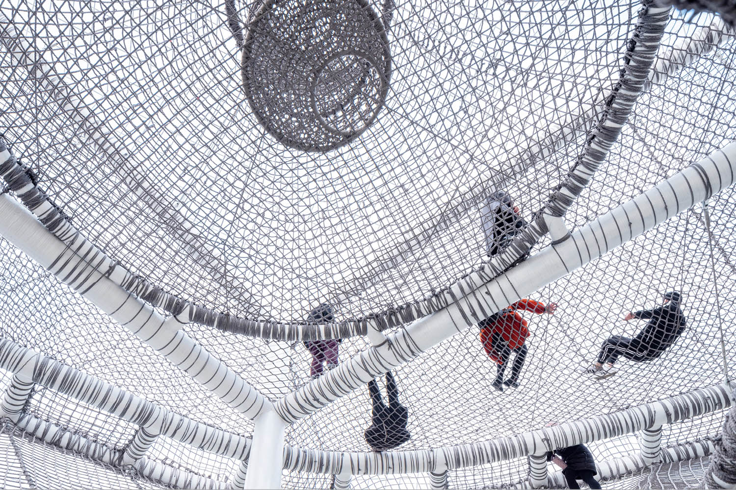 "THE ""CLOUD"" is a netted playground supported by steel structures, where children explore three-dimensional challenges. SASAKI"