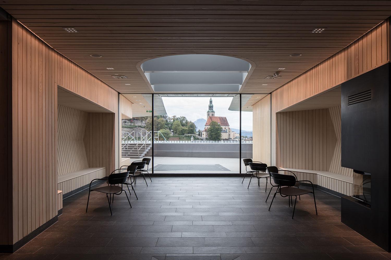 Sauna lounge focusing on the Mülln Parish Church Christian Richters │ Berger+Parkkinen Architekten
