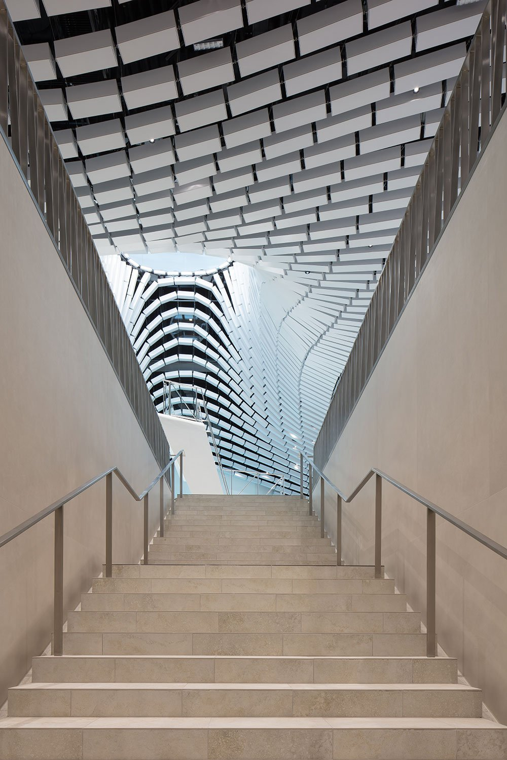 Central stairs leading to swimming level Christian Richters │ Berger+Parkkinen Architekten