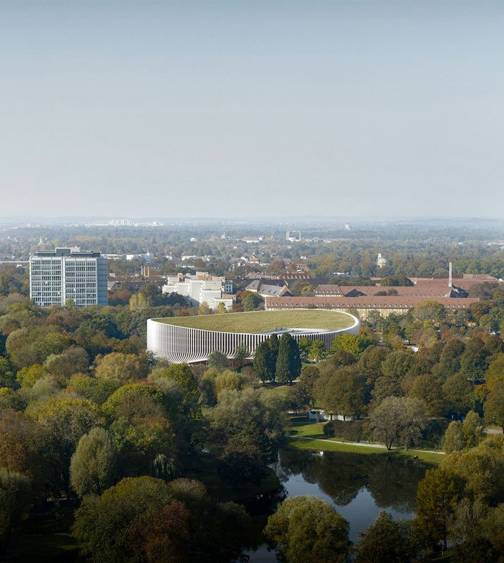 The arena itself is a simple oval, green roofed structure that naturally and respectfully melts into the park. 3XN
