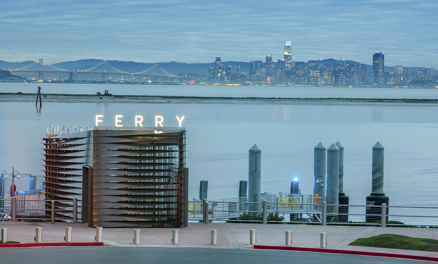 Terminal entrance at dusk, with the San Francisco skyline beyond. Billy Hustace