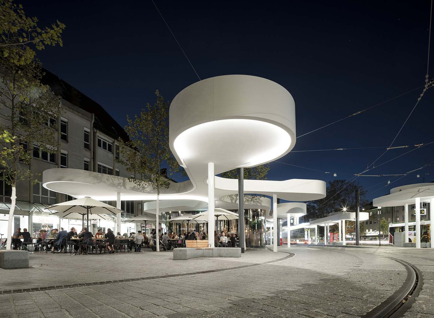 Perspective from East with Restaurant Use at Nighttime with Lighting David Franck