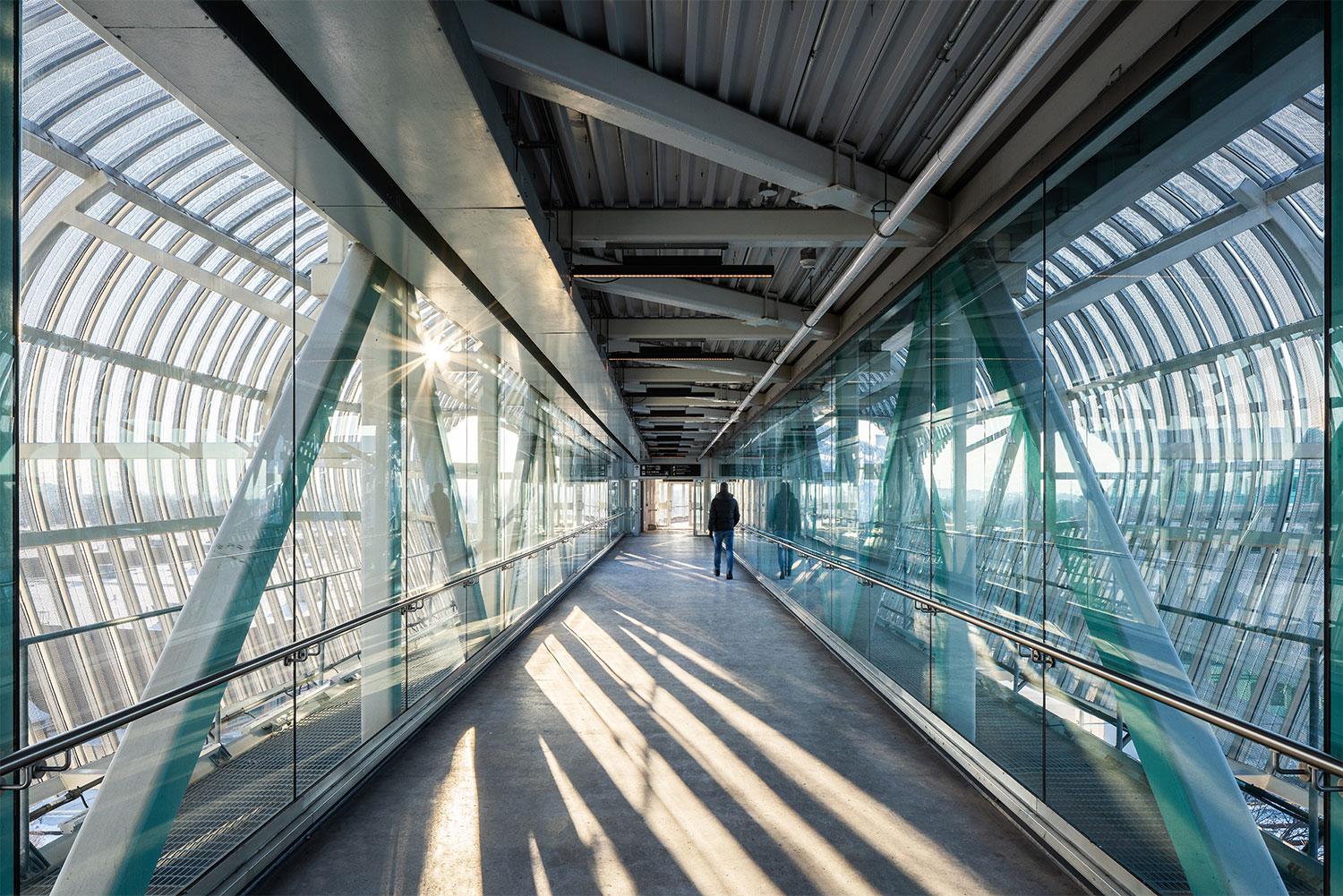 Interior view of the bridge. The bridge provides a vital pedestrian connection to the regions primary transit hub and between the north and south sides of the City of Pickering. Michael Muraz