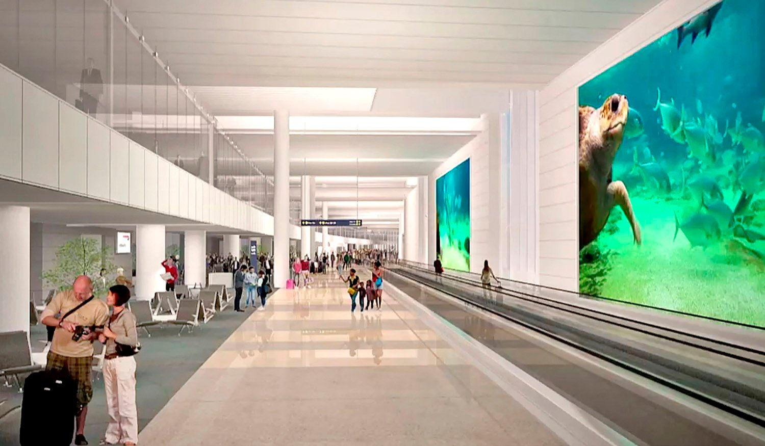 An elevated International Arrivals Corridor provides a welcoming first impression to international passengers. Fentress Architects}