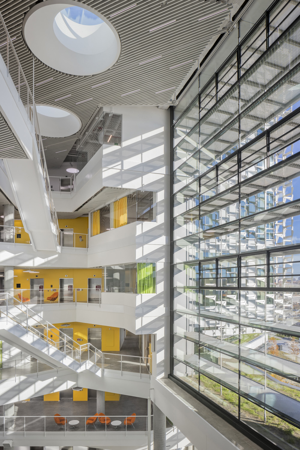 Two atria flood the interior with daylight, facilitate natural ventilation and serve as the communicative heart of the complex. Brad Feinknopf