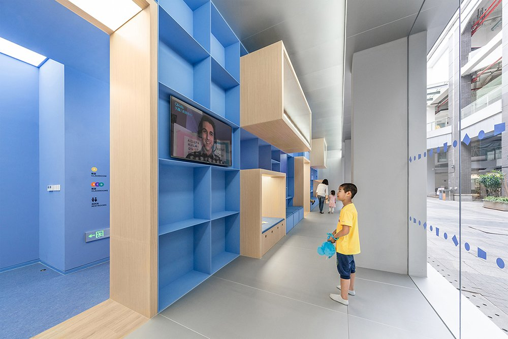 A child is interacting with an embedded screen BAI Yu