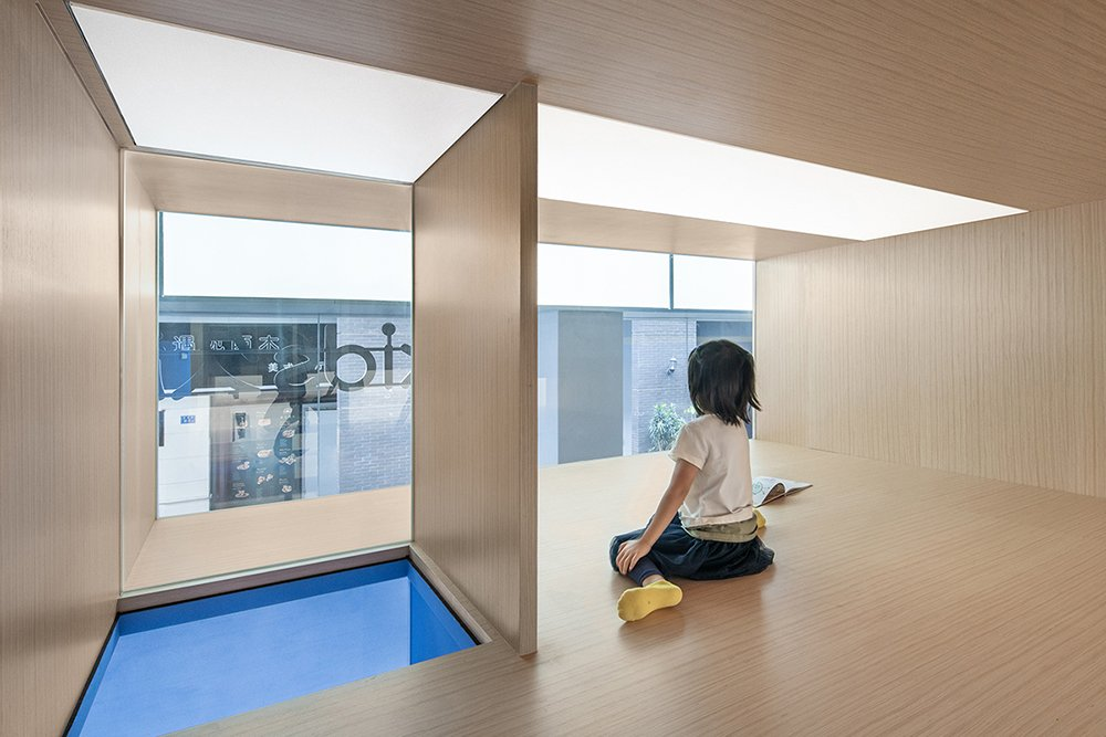 Children can climb up into the blue element and observe classmates below BAI Yu