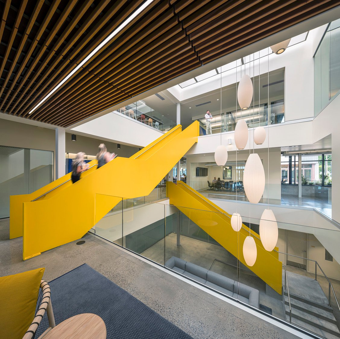 As Okland's logo is yellow the color was used sparingly, apart from the main circulation stair where concrete risers are enclosed in lacquered yellow steel, indicative of construction vehicles. Tim Griffith