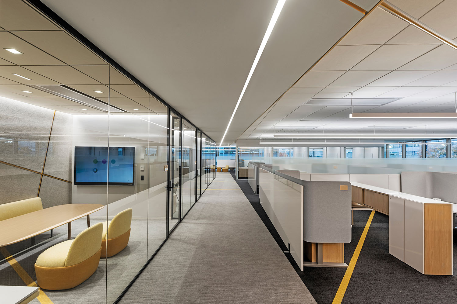 By pulling the collaborative environments into a specifically and centrally designed zone, individual open desks are allowed to remain quiet and distraction free Anton Grassl