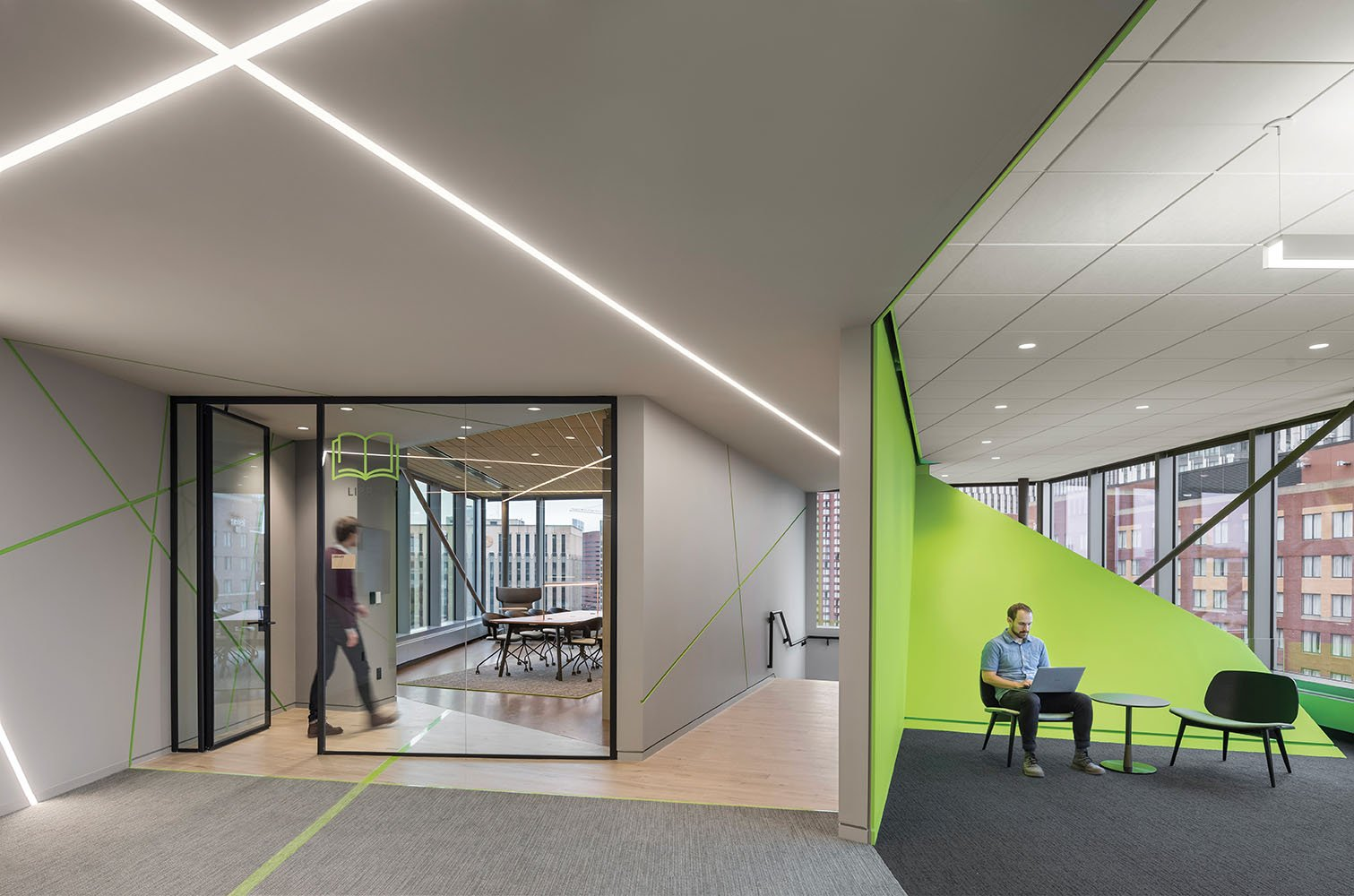 The exterior of the AkaMile is vibrantly colored across all floors, giving a clear indication of where to go to connect with co-workers Anton Grassl