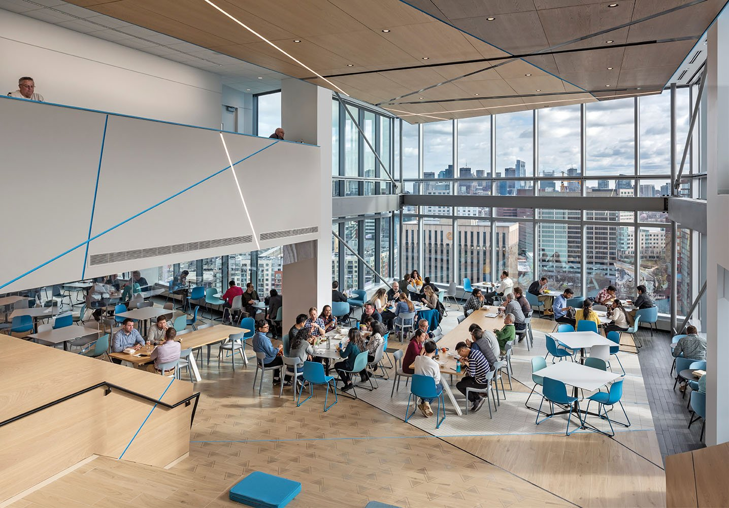 The employee cafeteria was located at the top of the building in the area with best views of the city. Giving this prime real estate to everyone is a hallmark of Akamai's dedication to its employees' exper Anton Grassl