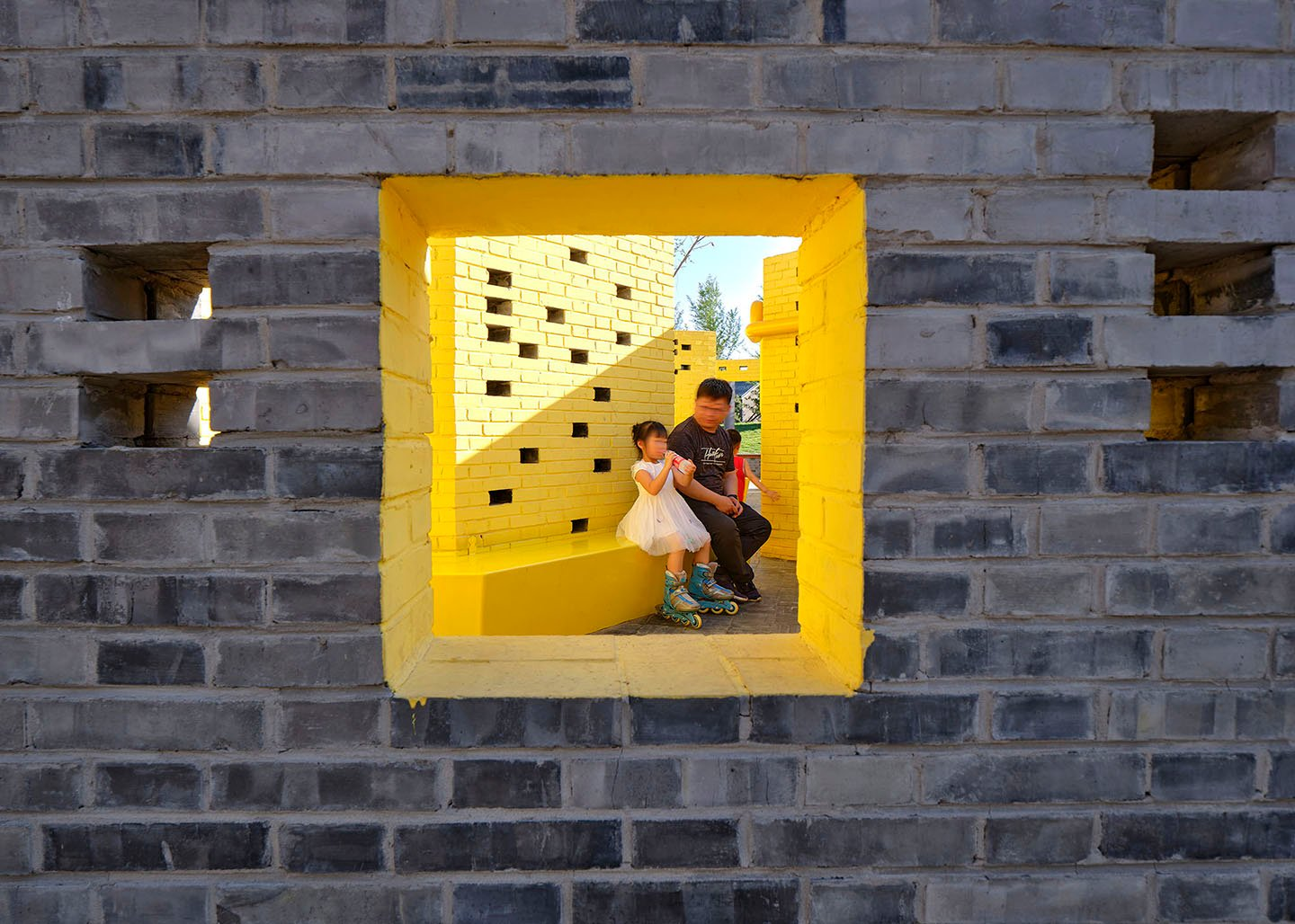 """View through into the yellow """"play room"""" YANG Chaoying"""