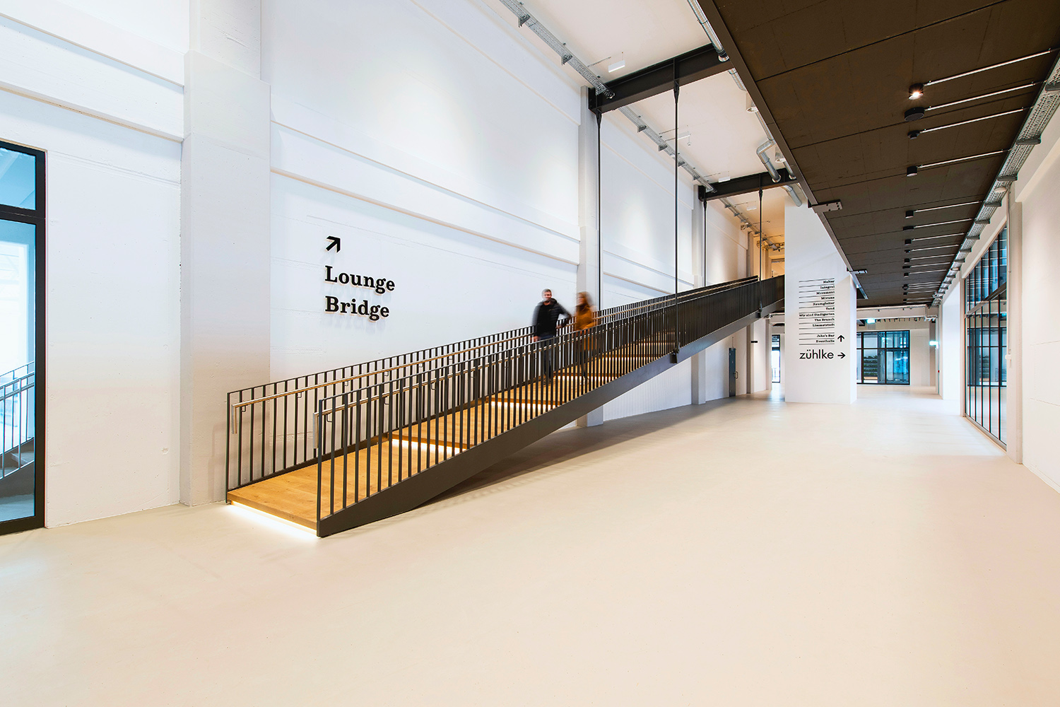 Second main entrance of JED. A new ramp leads to the first-floor spaces. Peter Wuermli