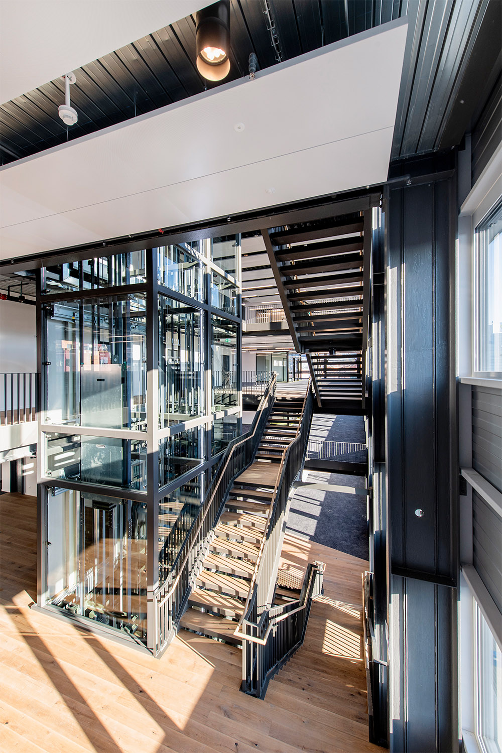 New light-filled atrium connects all floors in the new office building. Peter Wuermli