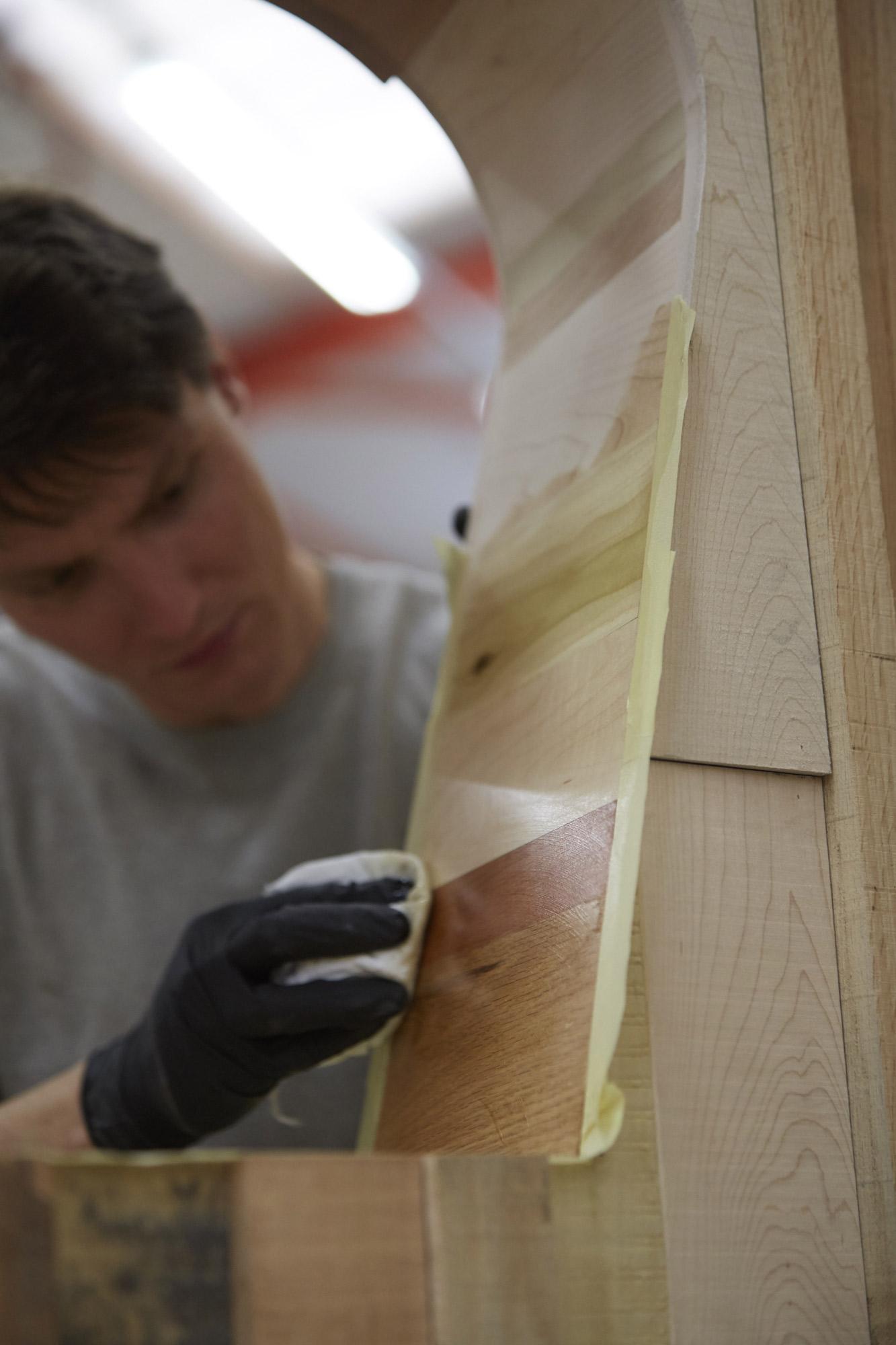 Too Good To Waste: Benchmark craftsman carefully applies finishing oil to the piece © Jon Cardwel