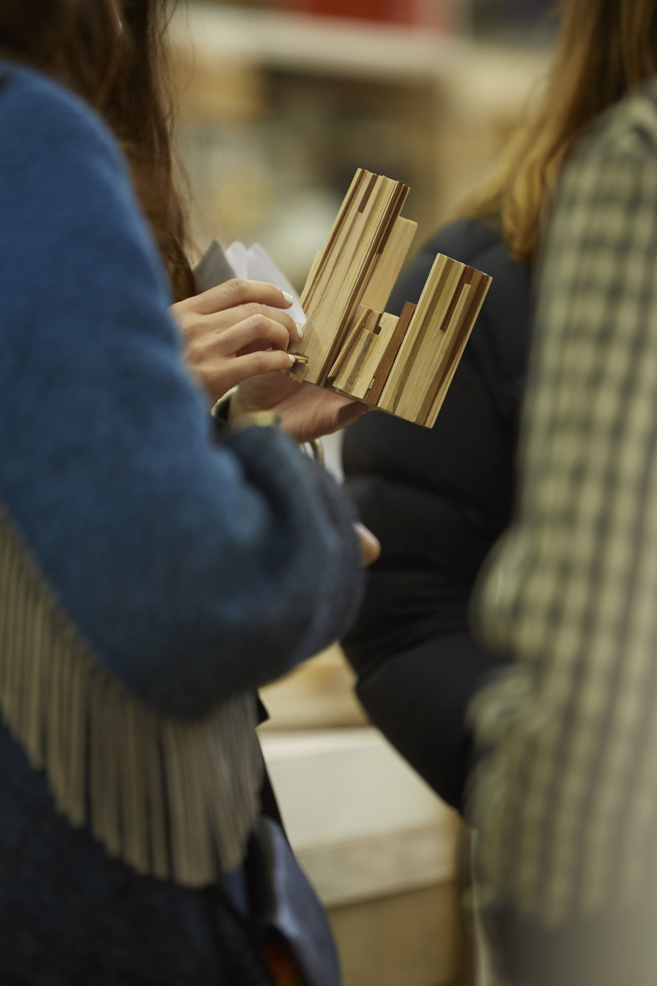 Too Good To Waste: Benedetta Tagliabue holds a wooden maquette of the installation © Jon Cardwel