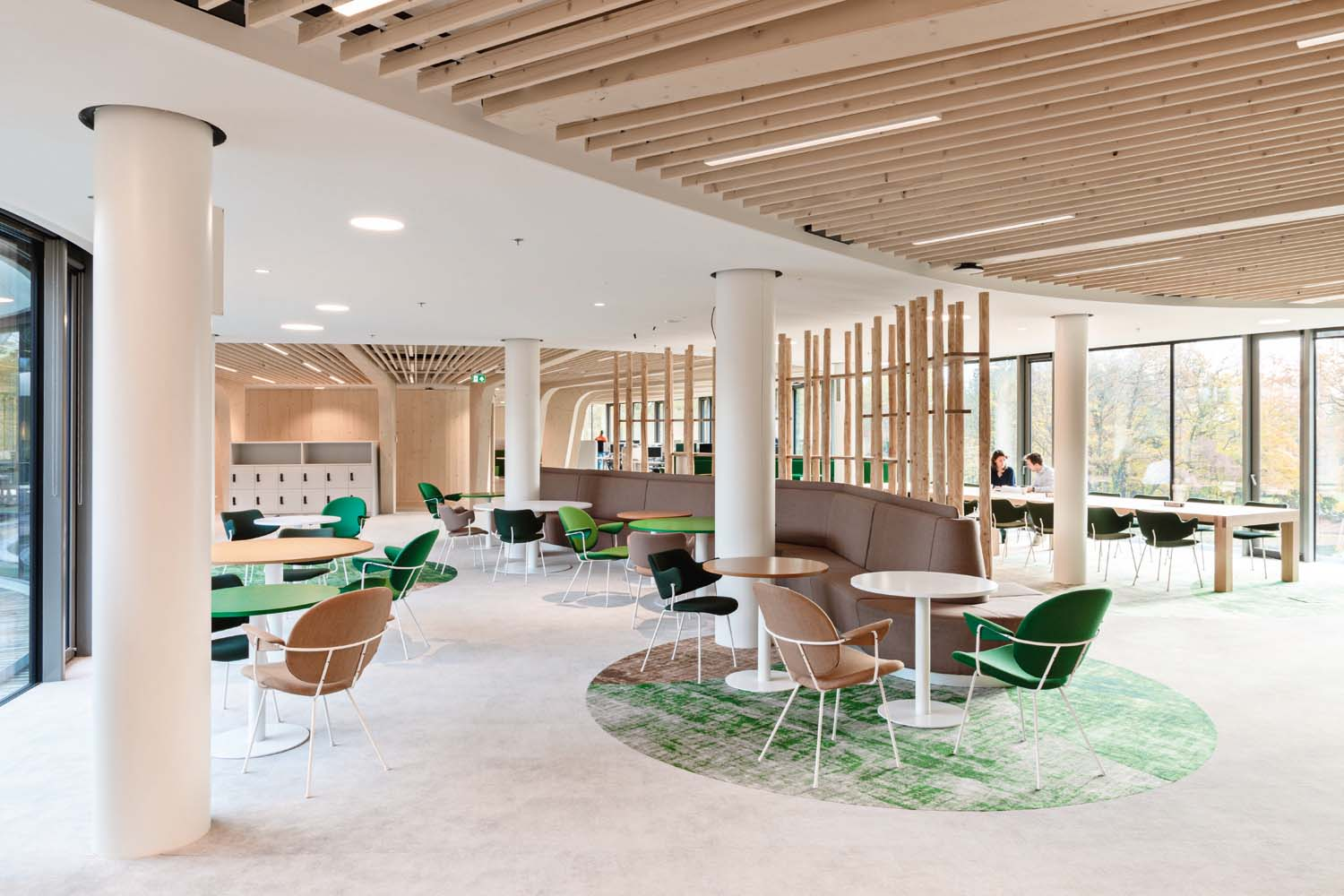 © Gispen, courtesy Ex Interiors The decision to adopt organic forms, sophisticated materials and natural colors infuses the environment with a sense of calm and reinforces the building's connection with its surroundings.