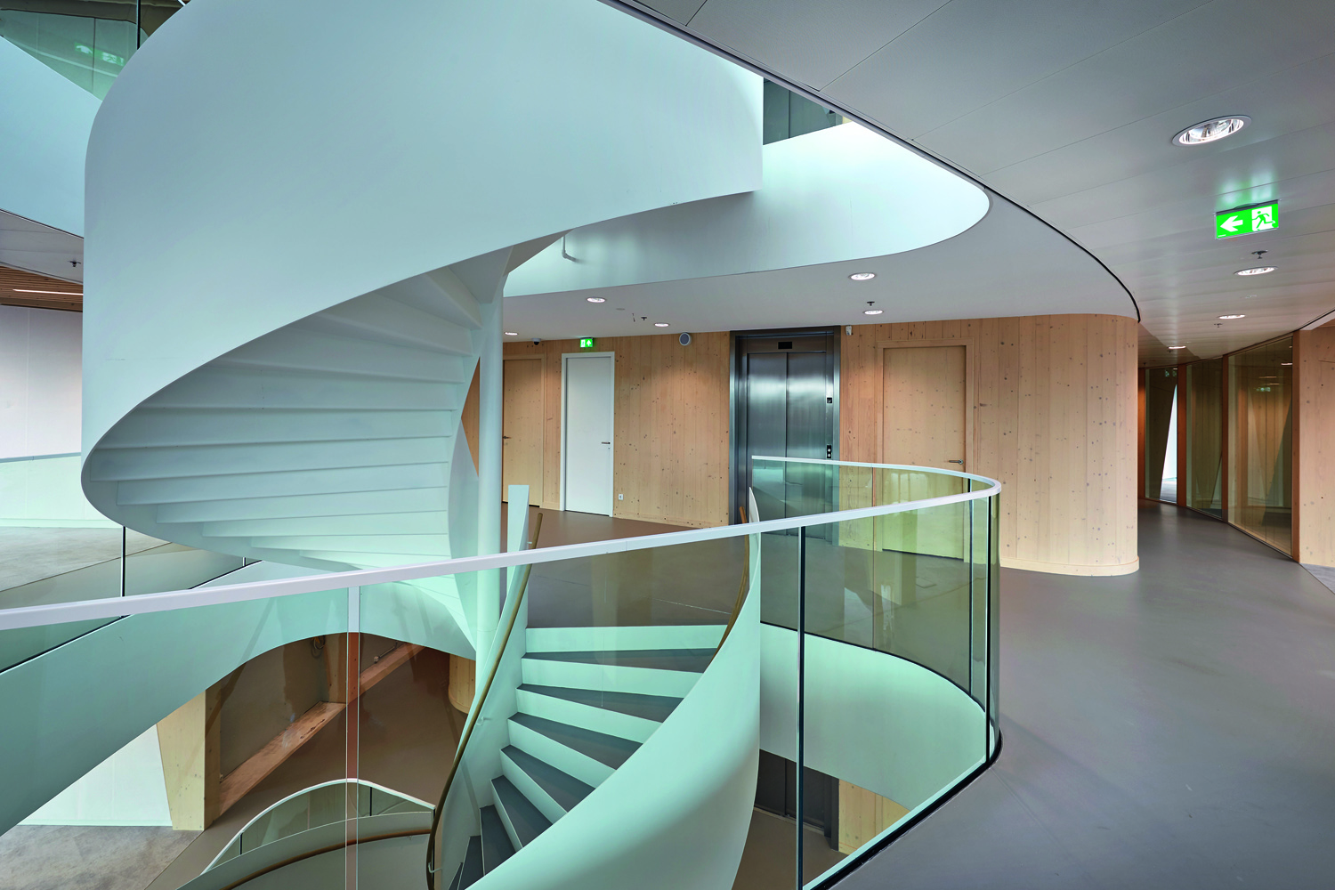 © Bert Rietberg, courtesy Ex Interiors The impressive, centrally-located spiral staircase is an invitation to take the stairs and limit elevator use.