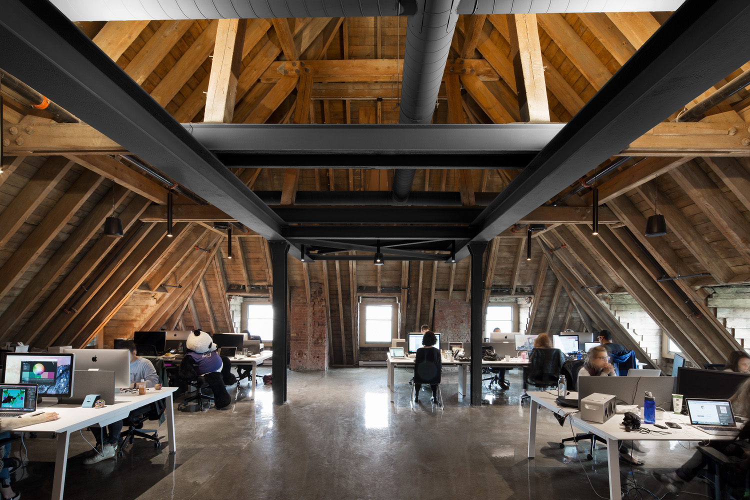 © Adrian Williams courtesy ACDF Architecture ACDF Architecture's design has restored the soul of the building, uncovering and highlighting its red brick and gray stone walls, wooden beams and steel structures.