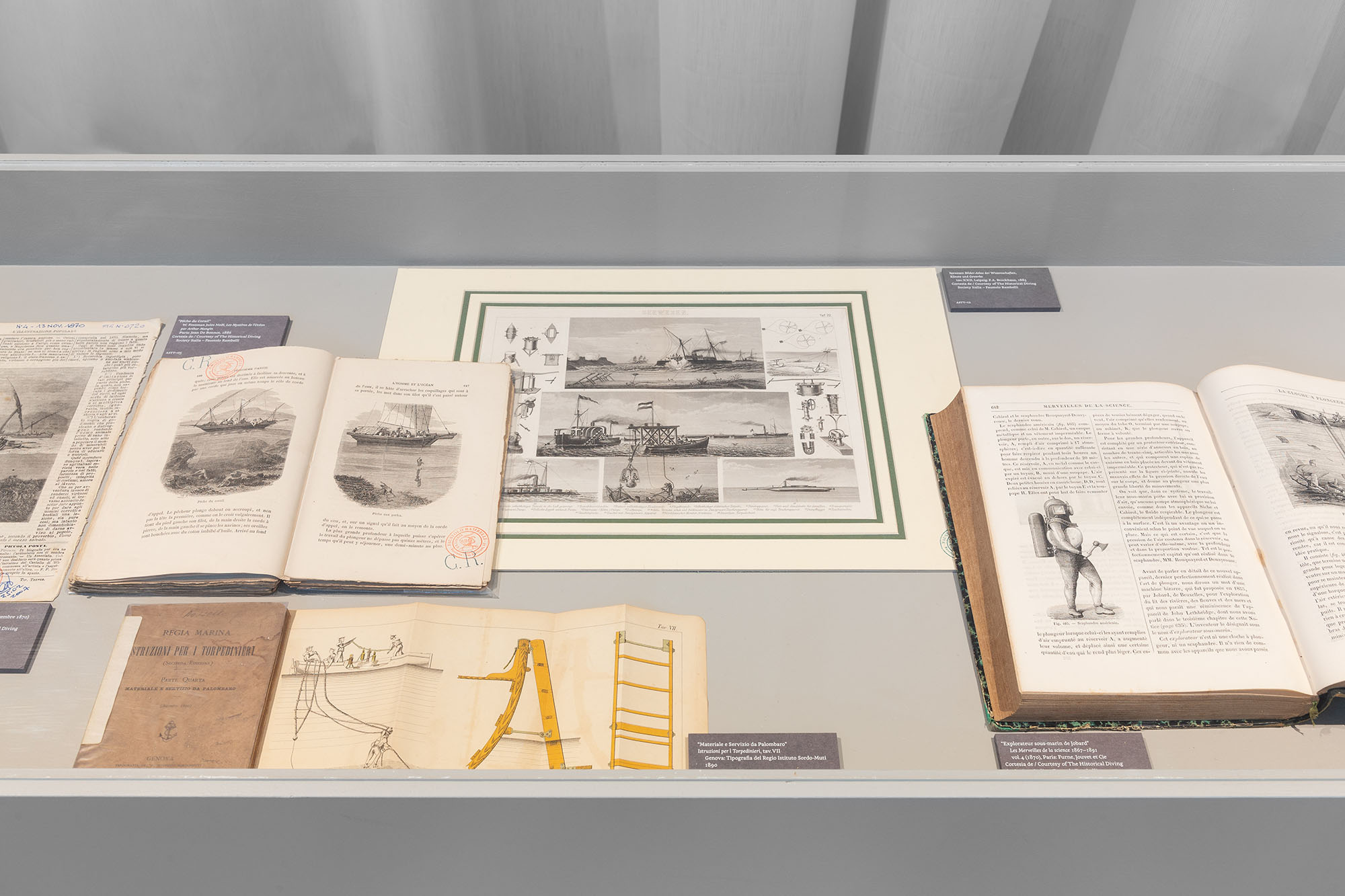 Aquaria – Or the Illusion of a Boxed Sea, view of the exhibition: detail of the showcases with documents. maat – Museum of Art, Architecture and Technology (Lisbon), 2021. © Courtesy of EDP Foundation. Photography by Bruno Lopes.