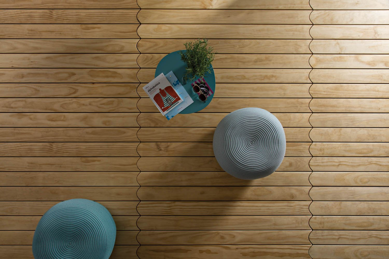 Courtesy of Listone Giordano Decking Biscuit, design by Patricia Urquiola, parquet in Accoya® or Ipe