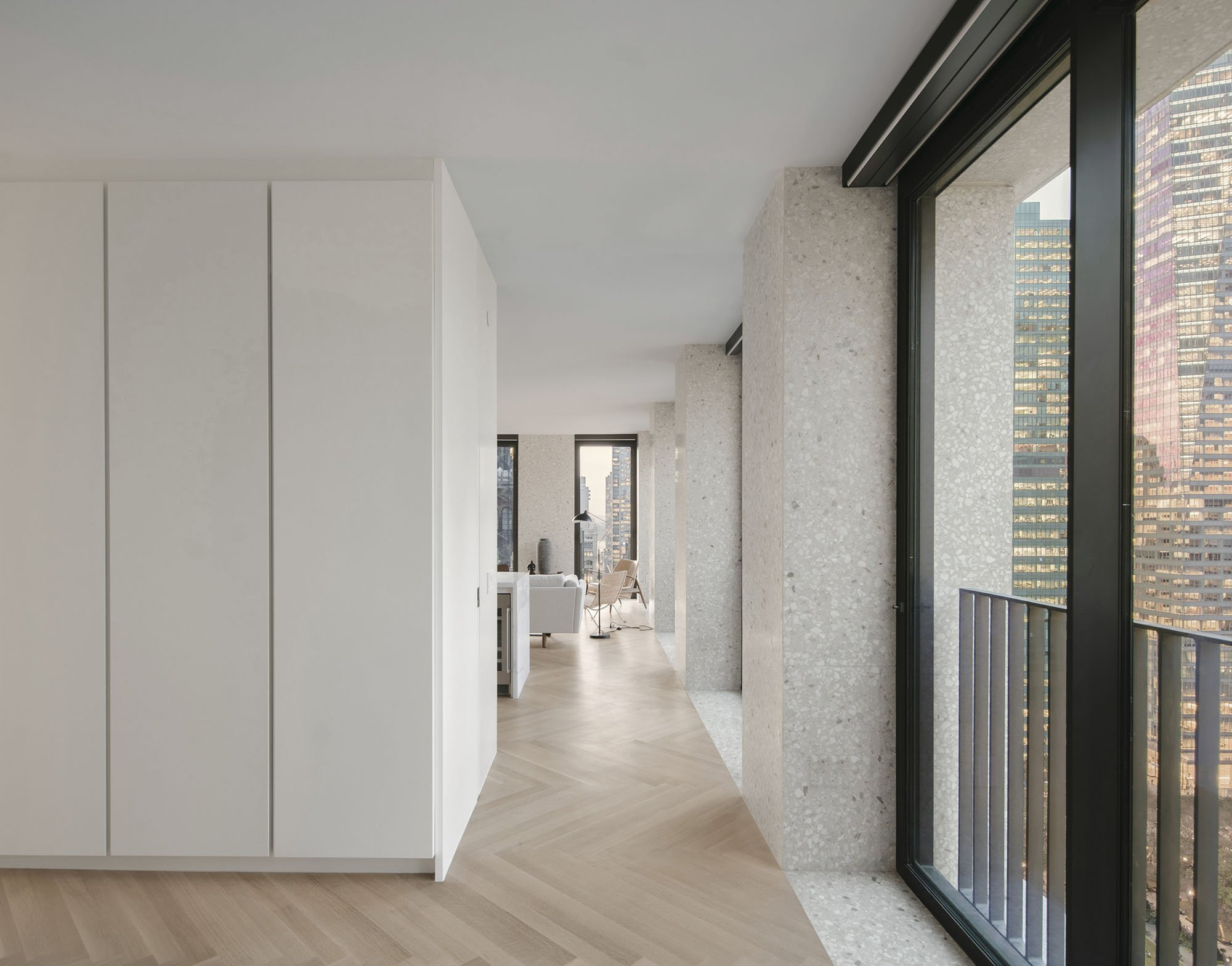 © Simon Menges The apartments' layout enables circulation around the perimeter of the building